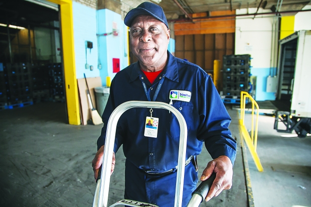 Dept. of Education Loader and Handler and Local 372 member Bill Clark has been serving the city since 1959, and is still going strong. Photo: Clarence Elie-Rivera
