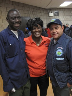 City Parks workers Mamadou N'doye (left) and vffff Medina with Local 1505 President Dilcy Benn at a union meeting.