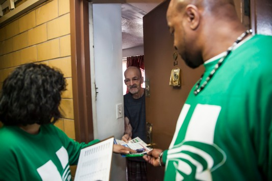 DC 37 activists went door-to-door in support of Hillary Clinton in the New York Democratic primary Pictured is Adalberto Soto, a resident at the Alfred E. Smith Houses in Manhattan's Lower East Side. Photo: Clarence Elie-Rivera