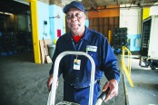 Bill Clark prefers delivering supplies to school cafeterias than working behind a desk.