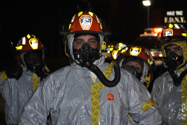 EMS crew wearing special protective gear rushed Ebola patient to Bellevue Hospital in October 2014.