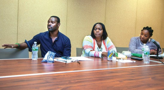 At their first meeting with DC 37 on June 23, Youth Care Workers Donald Holton, Suzanne Lewis and Kiena Hicklen describe the workplace conditions that prompted them and their coworkers to join the union. Photo by Mike Lee