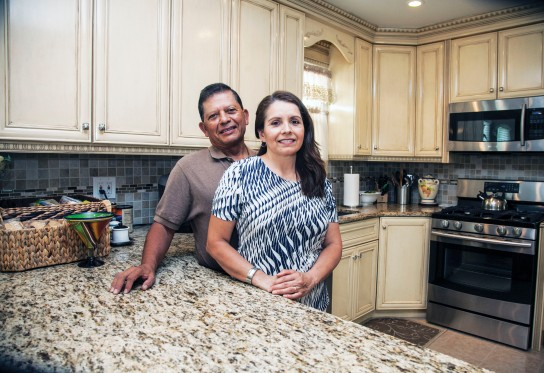 """""""We were in a bidding war with eight other buyers but because MEHP had our mortgage pre-approved, the owner sold the house to us,"""" said Local 376 member Ray Cabezas, Local 376, with wife, and Zoila. Photo Clarence Elie-Rivera"""