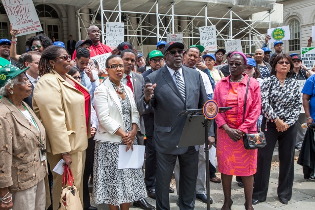 SSEU Local 371 President Anthony Wells, center, at a City Hall rally last year, negotiated an agreement with the city to maintain 15 NYCHA senior centers. Photo by Clarence Elie-Rivera
