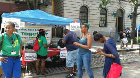During Harlem Week, DC 37 activists gathered petition signatures to press Gov. Andrew Cuomo to sign the Enhanced Safety Net Hospital bill.