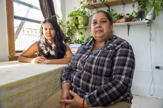 Eva Ozoria, with her daughter, is able to stay in her apartment thanks to the legal help of MELS attorney Admarie Llewellyn. Photo: Clarence Elie-Rivera