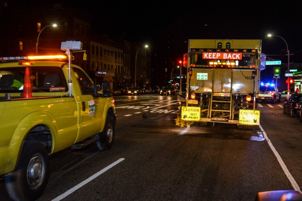Local 1455 work with NY marathon road runners to pain path lines on streets.