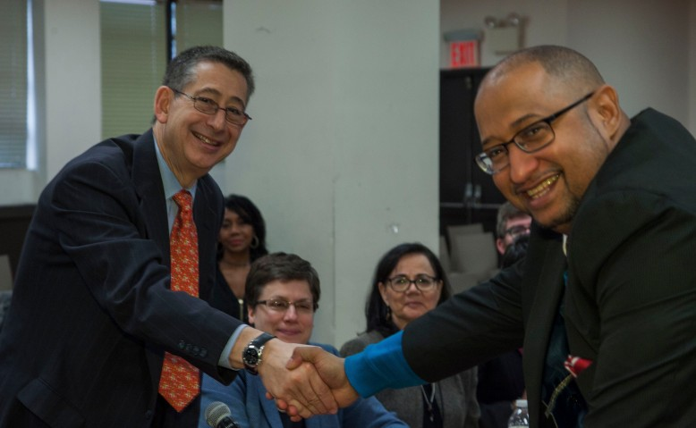 DC 37 Executive Director Henry Garrido, right, and Labor Commissioner Robert W. Linn shake hands after the union and city agreed on the contract extension. Photo: Mike Lee