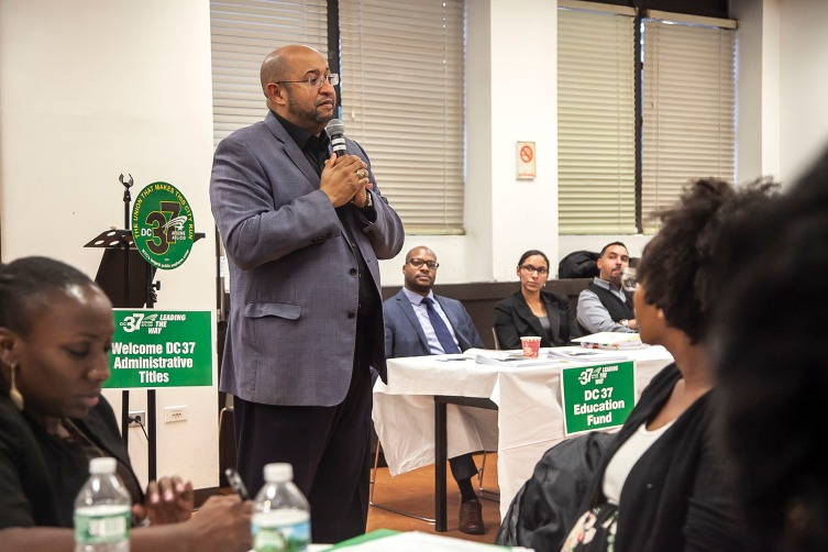 DC 37 Executive Director Henry Garrido speaks about the value of unionism at a town hall meeting on Oct. 24 for former mid-level managers who are now eligible to join the union because of a title reclassification. Photo: Clarence Elie-Rivera.